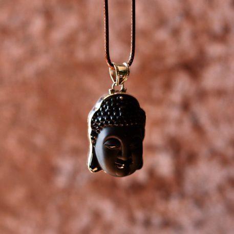 Cabeza de Buda de plata de ley artesanal tallada en un cristal de roca volcánica de obsidiana negra