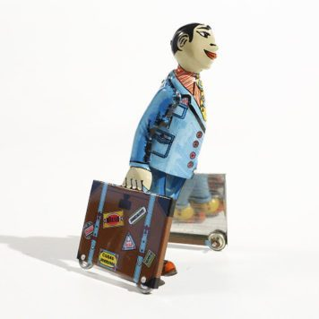 Student with suitcases